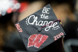Graduates put their creativity on display with decorated and W-themed mortarboards during UW-Madison's spring commencement ceremony outdoors at Camp Randall Stadium at the University of Wisconsin-Madison on May 17, 2014. The graduation event is being held at Camp Randall for the first time in more than two decades and is expected to be attended by approximately 5,400 bachelor's and master's degree candidates and their guests. (Photo by Bryce Richter/UW-Madison)