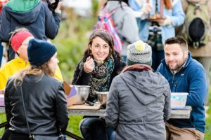 UW-Madison students enjoy a group dinner event at the Eagle Heights Community Gardens at the University of Wisconsin-Madison on Oct. 16, 2015. (Photo by Bryce Richter / UW-Madison)