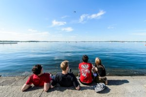 Amid ongoing construction, visitors to the Memorial Union Terrace enjoy a warm spring day on the shore of Lake Mendota at the University of Wisconsin-Madison on May 18, 2016. (Photo by Bryce Richter / UW-Madison)