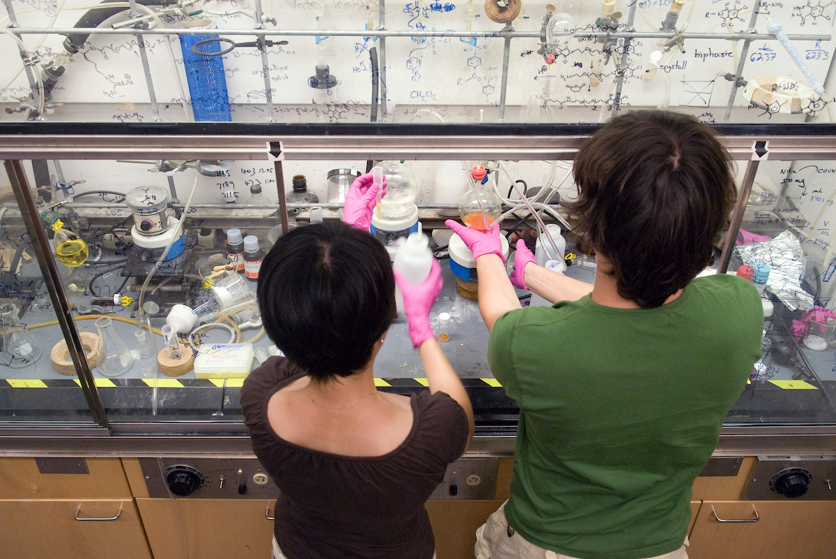 Graduate students Lingyin Li (left) and Ratmir Derda prepare materials under a fume hood in Laura L. Kiessling's research lab in the Chemistry Building at the University of Wisconsin-Madison on July 30, 2007. Kiessling is a Hilldale professor of chemistry and a Laurens Anderson professor of biochemistry.