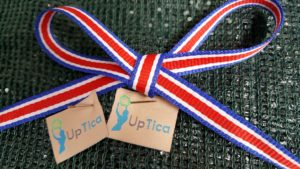 UpTica tags and ribbon sporting the colors of the Costa Rican flag