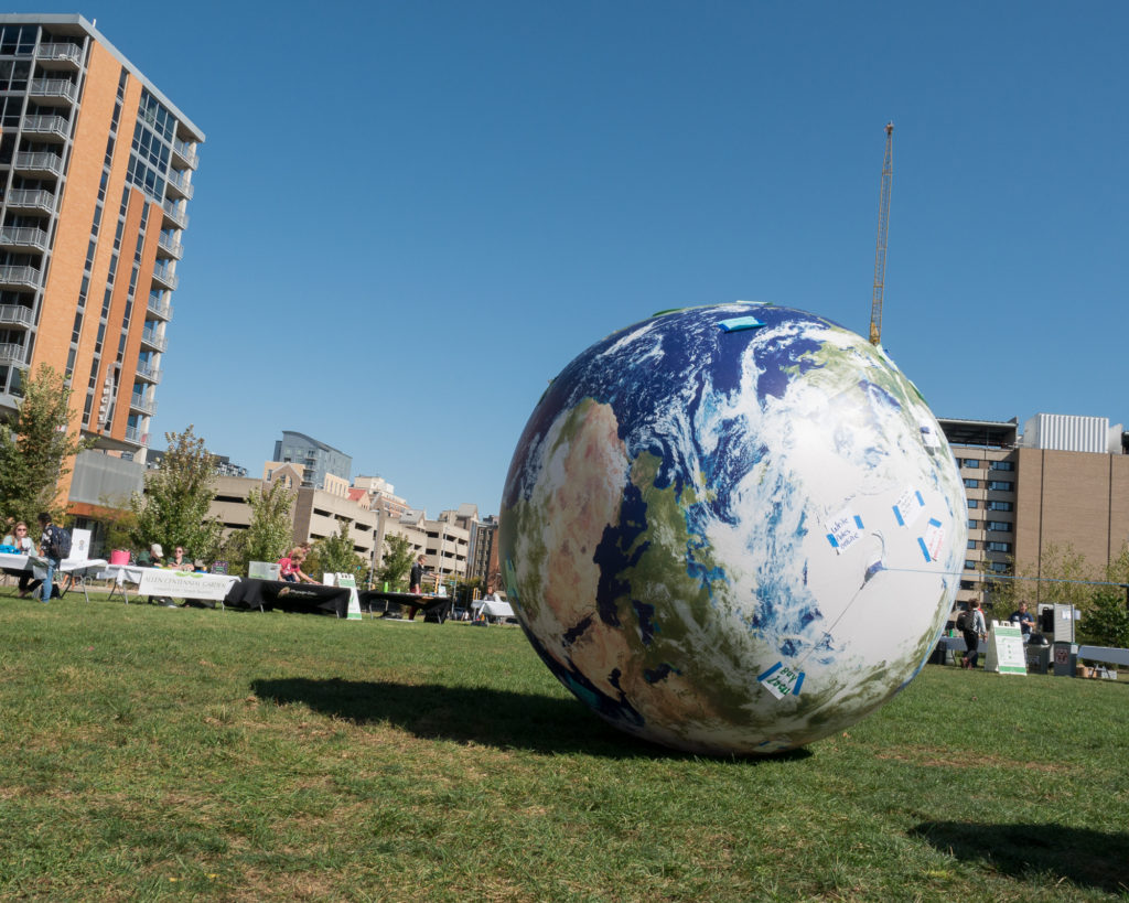 A giant earth rolls around the Gordon Lawn during Sustain-A-Bash, Fall 2017.