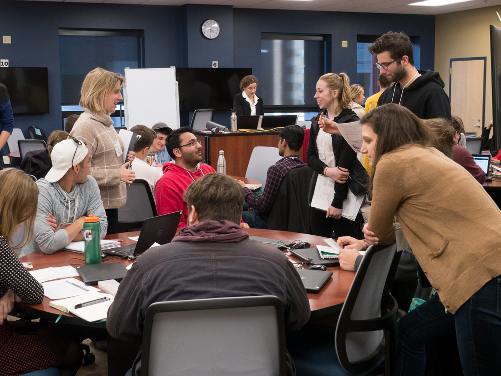 "Student delegates begin the negotiation process, with ""UN Leader"" Professor Ann Terlaak overseeing the action. Photo by Nathan Jandl."