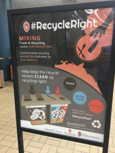 Informational posters about the #RecycleRight campaign compliment bin signs and table tents at College Library. Image courtesy of Carrie Kruse.