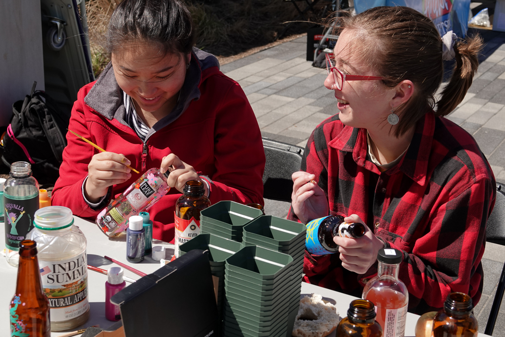 Participants paint pots at the OS/REThink Wisconsin table during the All-Campus Party Chalk the Block event.